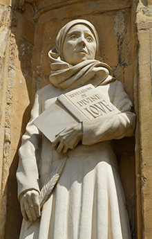 Photo of a statue of Julian of Norwich on the west front of Norwich Cathedral