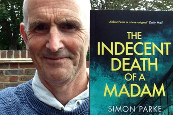 Simon Parke with his latest book, The Indecent Death of a Madam
