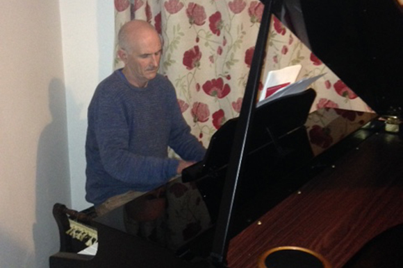Simon playing posh ivories